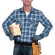 Smiling manual worker with wood — Stock Photo #11846529