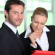 Businesswoman looking at businessman's notes — Stock Photo #11846559