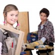 Kids in a craftsman workshop — Stock Photo