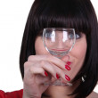 Woman watching meticulously an empty goblet — Stock Photo #11846631