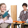 Little boy and girl in a craftsman workshop — Stock Photo