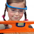 Young girl pretending to be a construction worker — Stock Photo #11846652