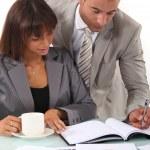 Man and woman interpreting financial results — Stock Photo