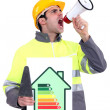 Stock Photo: Mwith energy rating poster shouting into megaphone
