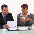 Businessman and secretary consulting files — Stock Photo #11846698