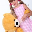 Girl with a stuffed toy — Stock Photo
