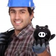 Electrician with a piggy bank — Stock Photo #11846709