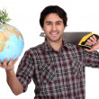 Man with a saw and a globe — Stock Photo