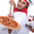 Stock Photo: Pizza chef and waitress
