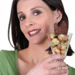 Woman holding a glass with Easter chocolate  eggs - Foto Stock