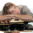 Stock Photo: A cute blond resting over a guitar.