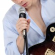 Young singer with a guitar — Stock Photo