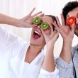 Couple messing around with fruit — Stock Photo