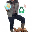 Tradesman campaigning to have more recycling facilities available worldwide — Foto de Stock