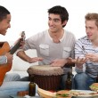 Convivial meal with music - Stock Photo