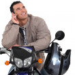 Man on a motorbike, studio shot — Stock Photo #11846962