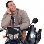 Man on a motorbike, studio shot — Stock Photo