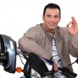 Stock Photo: Man on his motorbike making an okay sign