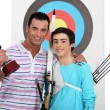 Father and teenage after victory in arbalete championship — Stock Photo