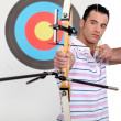 Stock Photo: Portrait of professional archer