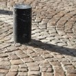 Royalty-Free Stock Photo: Post on a cobblestone street