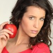 Stock Photo: Woman holding red apple