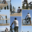 Tourists and bikes on a wooden pontoon facing the sea - Stock Photo