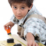 Little boy pretending to be carpenter — Stock Photo #11847180