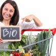 Woman with trolley of fruit and vegetables — Stock Photo