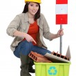 Female construction worker warning you to recycle old material — Stock Photo #11847193