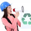 Stock Photo: Female construction worker promoting recycling.