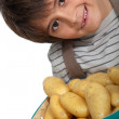 Boy with new potatoes — Stock Photo