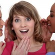 Three girls gossiping — Stockfoto