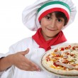 Child cook pizza - Stock Photo