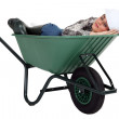 A female construction worker sleeping in a wheelbarrow. — Stock Photo #11847316