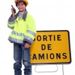 Young boy pretending to be a traffic guard - Stock Photo