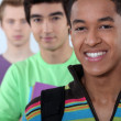 Three male student in line. — Stock Photo #11847346