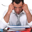 Frustrated businessmwith files — Stock Photo #11847356