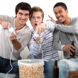 Three male teenagers playing video games. — Stock Photo #11847360