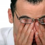 Tired man rubbing his eyes — Stock Photo