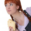 Woman with a block of Swiss cheese — Stock Photo