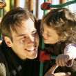 Father and daughter at a playground — Stock Photo #11847390