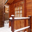 Stock Photo: Snow covered holiday cabin