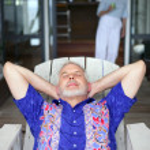 Senior man relaxing on a veranda — Stock Photo #11847491