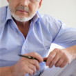 Pensive gray-haired man — Stock Photo #11847541