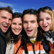 Stock Photo: Portrait of friends on skiing holiday together
