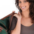 Woman carrying bag by handle — Stock Photo #11847584