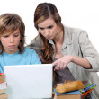 Stock Photo: Two kids studying together
