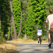 Riding bikes in a forest — Stock Photo #11847676