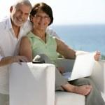 Senior couple surfing the internet — Stock Photo #11847697